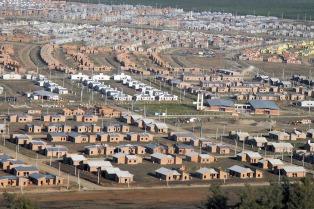 Presentan propuesta para urbanizar en 12 años a los 4500 barrios populares del país