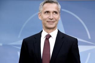May y Stoltenberg piden a los países de la OTAN que aumenten su contribución