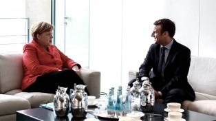 Macron y Merkel propondrán refundar el euro y la Unión Europea