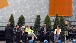 Merkel y Obama llaman al activismo democrático en un multitudinario acto