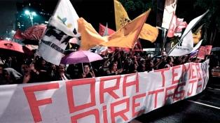 Temer enfrenta una semana, acorralado por la Justicia y una huelga general