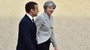 May y Macron firman un nuevo acuerdo fronterizo para Calais