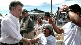 El presidente Santos y miembros de las Farc
