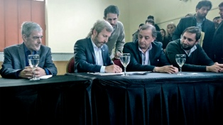Frigerio firmó convenios con Das Neves para la reconstrucción de Comodoro Rivadavia