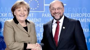 Merkel promete inversiones para atraer a los renuentes socialdemócratas y formar gobierno