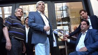 Triaca y Moyano juntos, con gestos de acercamiento y críticas a la corrupción sindical
