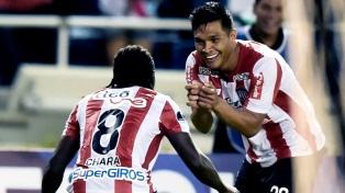 Entre Guaraní y Junior se define hoy uno de los rivales de Boca