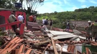 Identifican 151 cuerpos y evacuan la zona donde se rompió una represa
