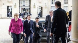 Juncker, Merkel y Macron unen fuerzas para equilibrar la relación con China