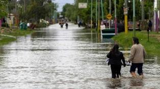 """Garro: """"No olvidamos el abandono"""" sufrido en la inundación de 2013"""