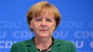 Merkel reiteró su deseo de una victoria de Macron en Francia