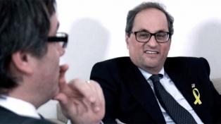 """Torra y Puigdemont piden """"diálogo sin condiciones"""" a Rajoy desde Berlín"""