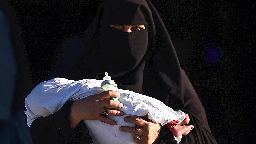Una mujer con burka que, en principio, no sería obligatorio.