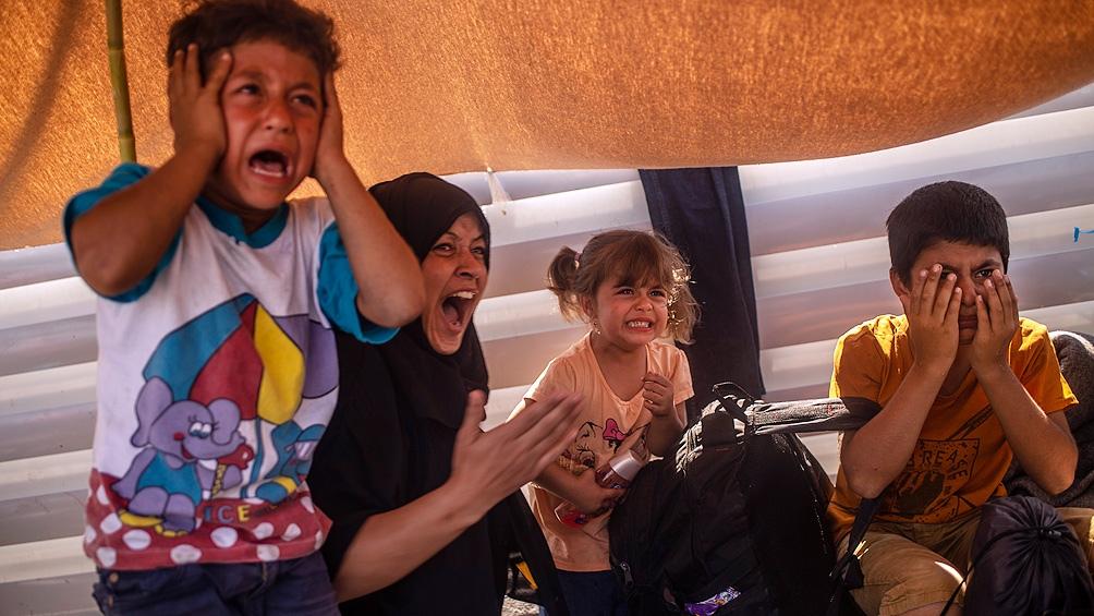 """Los refugiados reclaman """"libertad"""" y piden salir de la isla."""