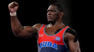 Atletas cubanos que ganaron medallas de oro dedicaron sus triunfos a Fidel Castro