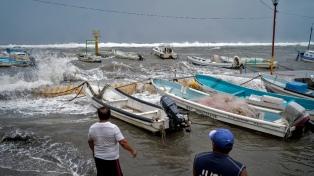 Al menos 7 muertos por el huracán Grace, que se degradó a categoría 1 en su avance