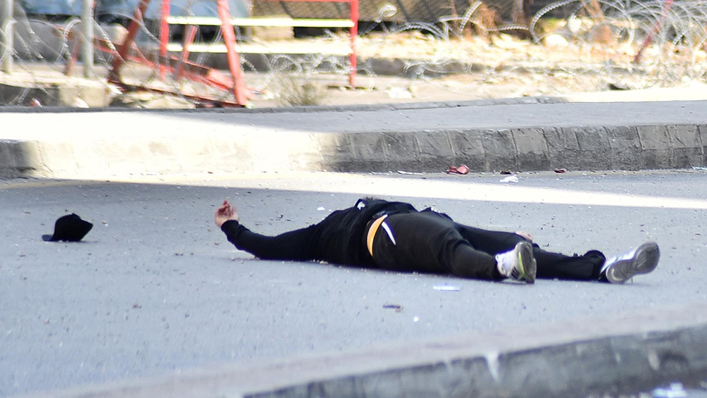 El ministro de Interior informó que ya había seis muertos y que algunos habían recibido una bala mortal en la cabeza. Foto: AFP